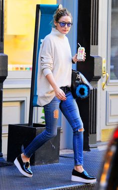 Olivia Palermo kept her look casually cool with distressed jeans, an oversized turtleneck sweater, a messy topknot and sunnies with flash lenses!