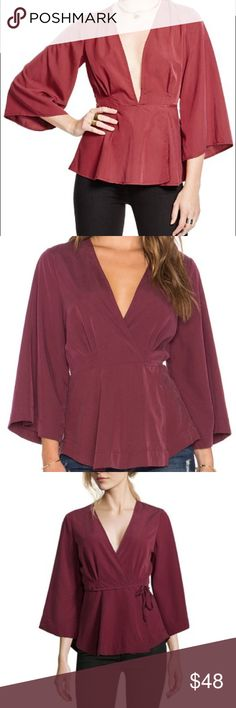Free People Grand Piano Wrap Top Modal/polyester Machine wash Imported Deep v-neck, flared three-quarter sleeves, wrap front with string tie closure... this was a sample size (XS/S- 2/4) Free People Tops