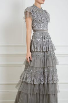 NEW SEASON CR19. As the name suggests, enjoy this fairytale moment. The Cinderella Gown is making our dress dreams come true. This floral embroidered gown in ash combines delicate lace with sparkling embellishment. The pretty collar and tiered panels make it the perfect style for events this season.