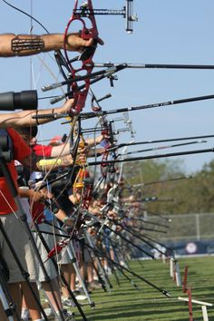Great shot of recurve bows down the line of competition at a tournament.