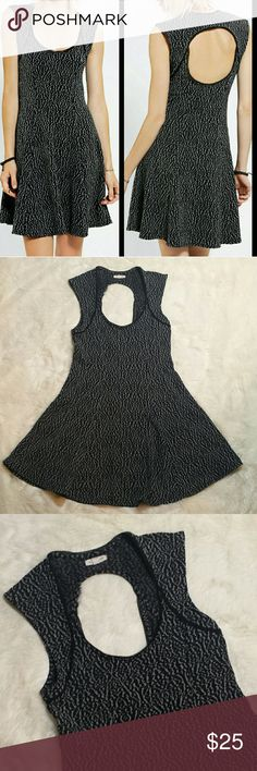"UO Silence + Noise Open Back Skater Dress Sz Large Urban Outfitters Silence + Noise Open Back textured skater dress. Scoop neck dress with a flattering fit and flare. Gray background with black textured lace design. Open back. Soft and stretchy with side zip entry. Preowned in great condition with no rips, holes, tears or stains. Size large.   Measurements  Pit to Pit 16.5"" Waist 15"" Top of shoulder to bottom hem 35"" Urban Outfitters Dresses"