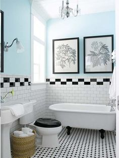 Black and White and Blue.. Oh My!  So much I love here.  The tile work, the chandelier, the clawfoot tub!