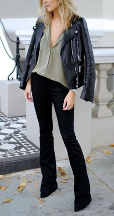 Your Friday date night look decoded: flared dark jeans, loose silk blouse, and leather moto jacket.