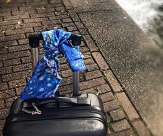 Flamboyant design of blue patterns. Electric blue. Tied on a luggage before traveling.