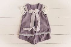Pretty lavender textured sitter for a 6-12 month old. Trimmed with silk chiffon rosettes and silk ties , it has the perfect old fashioned,