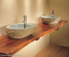 Natural wood counter top. Would love this, but with a darker wood/stain and different style sinks!