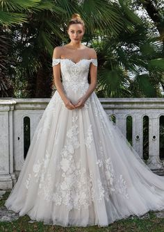 Feel like a princess in this Venice lace ball gown. With Point D'esprit tulle and off the shoulder detail. You will be remembered when you walk down the aisle.  COLORS Nude/Ivory/Nude, Ivory/Ivory/Nude, Sand/Ivory/Nude