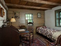 Why is this room so appealing to me? The wood, the plaster with green windows, the quilt, the lack of clutter... that's my guess.