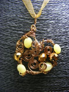 Heart Pendant Necklace wire wrapped Yellow Opal Gemstones, Bronze Crystals and Bronze Wire