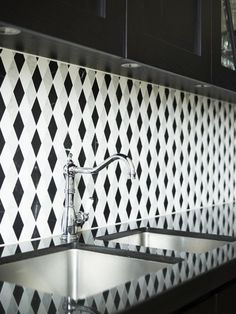 Black and white trellis pattern mosaic tile on a kitchen backplash...see COCOCOZY Kitchens board to see rest of space! http://cococozy.com