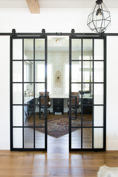 Sliding black steel and glass barn doors + modern barn doors + white subway tile walls in the office + vintage area rug Home Room Design, Dream Home Design, Home Office Design, Home Interior Design, Glass Barn Doors, Glass Office Doors, Modern Barn, Modern Farmhouse, House Rooms
