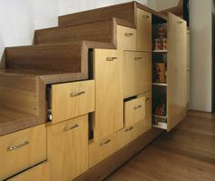 Utilise the often wasted space under stairs. Drawers and pullout cupboards, like those designed for kitchens, ensure every centimetre is accessible right to the farthest, deepest corner. A top place to store pantry items, linens and a whole lot more. For interest, vary the height and width of the drawer/cabinet fronts. If you prefer a minimal look, dispense with handles and opt for touch-open fittings.