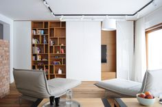 WIDAWSCY STUDIO ARCHITEKTURY have designed the House in Myslowice, Poland.White walls, antiqued floorboards and old brick give the interior nature of the loft / attic. In this remarkable home White Floor Lamp, White Ceiling, White Walls, Living Room Tv, Tiny Living, Modern Interior Design, Interior Architecture, Apartment Walls, Sliding Wall
