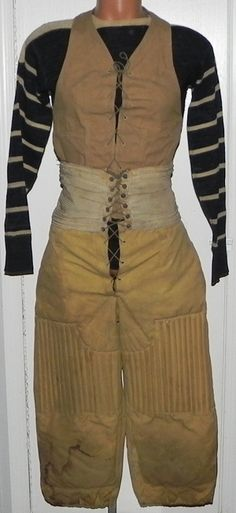 Turn of the Century Spalding Football Union Suit Uniform Ensemble.  This rare and fantastic early football uniform features a lace-up smock vest, reeded and heavily horsehair padded football pants with attached elastic waist band, and a striped sleeve wool football sweater.