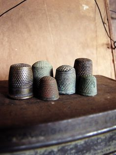 Antique thimbles.        My husband's grandmother was born in 1880;  I have several of her old thimbles that she used to support her and her sons by taking in sewing and mending...