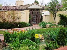 Unique Iron Gate with Stucco Fence Montclair by Extra! Extra! Homes, via Flickr