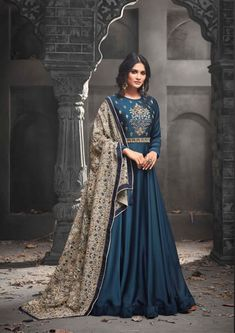 Teal Blue Georgette Party Salwar Kameez - SKMOHI49001 Teal Mudal Silk Satin Anarkali Salwar Kameez with Thread and Zari Embroidery. Extremely Desirable Style Ethnic Anarkali Suit with Bottom of Santoon Fabric. Comes with a matching Georgette Dupatta.