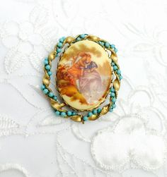 A personal favorite from my Etsy shop https://www.etsy.com/listing/112502303/art-deco-brooch-victorian-couple-painted