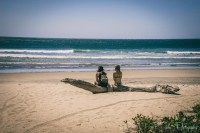 Costa Rica travel tips: Two backpackers on the beach in Playa Guiones. Nosara. Costa Rica
