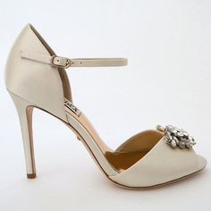 Badgley Mischka Bandera Ivory Wedding Shoes. Crystal ornament and ankle strap bring vintage glamour to a gorgeous wedding shoe