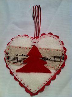 Hand sewn, felt heart christmas tree decoration, white and red. $7,00, via Etsy.