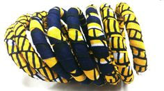 Check out this item in my Etsy shop https://www.etsy.com/listing/246651174/blue-yellow-curled-ankara-bracelet