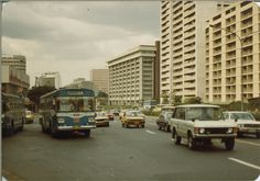 January 1983 Makati down from the Allied Bank is the Insular Life Bldg. you can see the bldg. above the Blue Bus Monumento. Blue Bus, Makati, Philippines Travel, Pinoy, The Expanse, Old Town, Tuscany, Old Photos, Nostalgia