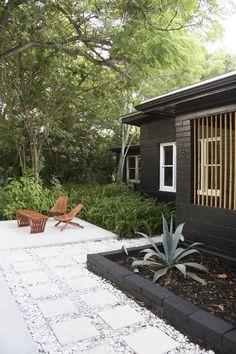 entrance-florida-black-painted-house-concrete-pavers-gravel