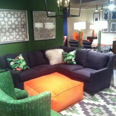 We partnered with  at this year's High Point Market to help them decorate their showroom. Loving the orange pop against  Alameda Rug from Surya. (AMD-1048)