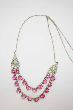 Art deco silver-plated necklace with pink paste collet-set stones.  Firedrake Jewellery & Antiques.