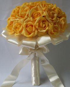 Rosas amarelas com cabo todo em cetim. https://www.facebook.com/buquedenoiva.rj/?ref=bookmarks