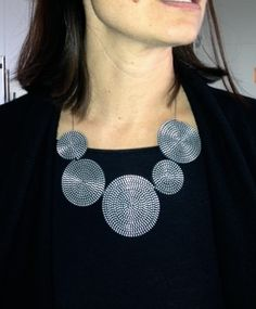 Our CEO's fabulous #upcycled necklace, made of old zippers!