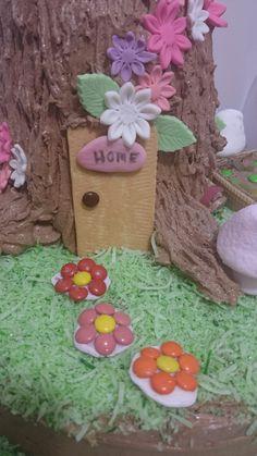 Fairy tree trunk house mud cake buttercream coconut grass fondant flowers vegetable garden ladybird birthday girl