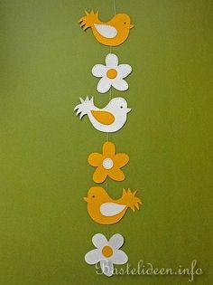 Basteln mit Kindern - Bastelideen - Fensterbild - Vogel und Blume Kette