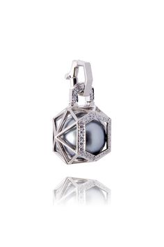 Perle Captive Couture Charm- Sensual and lustrous, the caged pearl is surrounded by luxury. A single round finest-quality Tahitian black pearl is held captive by the intrigue of a polyhedron cage replete with delicate diamond pavé. A rare couture charm exhibits classic elegance but a modern vibe; simply timeless and so versatile - Handcrafted in 18K white gold in our NYC atelier. 9mm pearl. Approx .10ctw diamonds. Each made to order. $2800