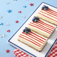 Decorate these easy cheesecake bars as American flags by using blueberries for the star section and piping jelly in thin lines to...