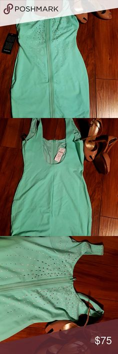 BEBE DRESS Front zippered BEBE dress, new with tags, lined, low back,  size M, I wear small and medium and fits me, color is teal,  first pictures reflect color better. Just a little lighter teal. BEBE Dresses Mini