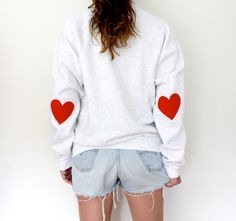 Summer SALE! reg. price $34.00    Wear your heart on your sleeve <3 DETAILS:  * Grey sweatshirt embellished with red felt heart patches on the elbow. *