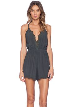 73199554431b Loose Deep V-neck Spaghetti Strap Pure Color Short Jumpsuit