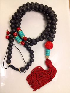 Cinnabar Tassel Mala Necklace on Etsy, $46.00