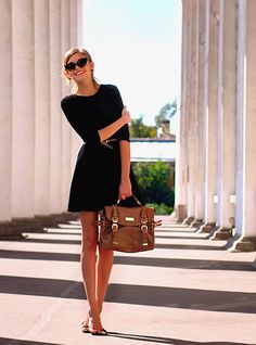 Black dress with sleeves, great sunglasses, and a brown bag.