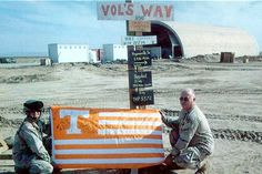 Tennessee Vols Way - Solidiers holding a Tennessee Vols flag.