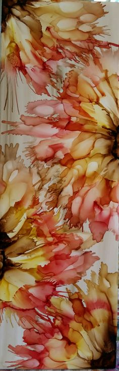 Blended flowers in alcohol ink on 12x4 ceramic tile by Tina.