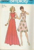 An unused original ca. 1975 Simplicity Pattern 6882.  The short or long dress with flared skirt stitched to shaped bodice at normal waistline has back zipper and pleated bodice front forming a squared cowl neckline. The short dress is regular length; long dress is floor length.