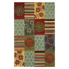 Hand-tufted New Zealand wool rug with a patchwork motif.  Product: RugConstruction Material: WoolCol...