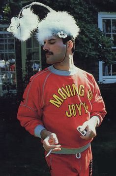 Freddie Mercury Clowning around a bit. He loved jokes, mischief, had a great sense of humor, & was very playful.