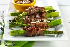 Beef-Wrapped Asparagus Spears with Sesame and Chipotle Sauce   Start off a meal or party with this impressive, flavor-packed appetizer. Canola oil is the best choice for searing here because of its high smoke point (468 °F).