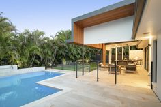 Modern outdoor entertainment area extension pool design north lakes pool &a Entertainment Center Makeover, Entertainment Center Kitchen, Entertainment Room, Disney Family, Tv Decor, Tv Stands, Pool Designs, Ikea Hack, Outdoor Entertaining