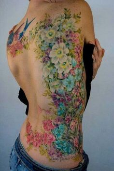 Pastel floral tattoo featuring birds.  This is gorgeous.