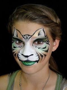 Christina Davison Green and Gold Tiger-Cat Face Painting. Love the suggestion of ears just using two tones and some simple black brush strokes. It's all about the shape.